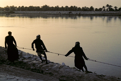 Sunset on River Euphrates at Nasiriyah, Iraq. Photo by Ferrell Jenkins in 1970. Biblicalstudies.info.